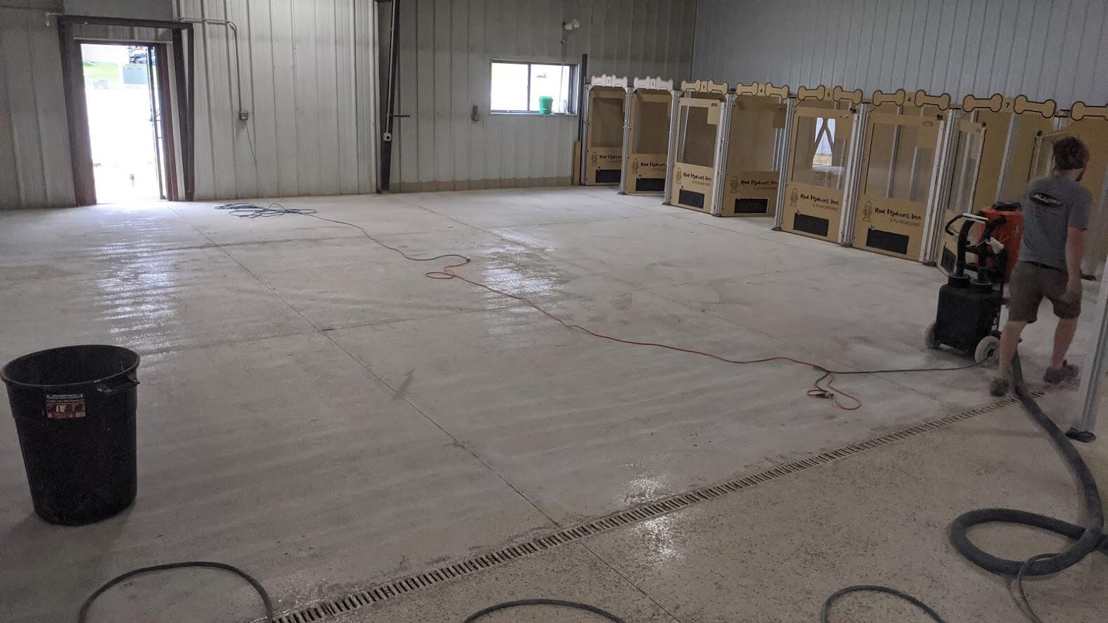 Sanding off old epoxy flooring.